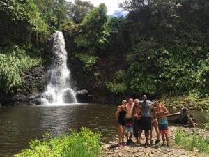 In front of Hawaiian waterfall